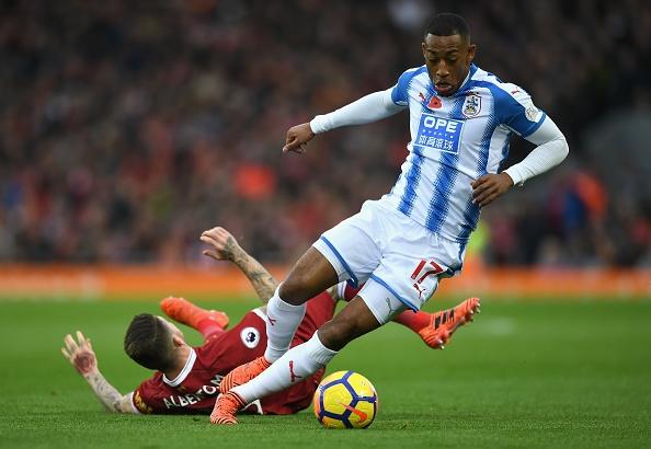 Liverpool 3-0 Huddersfield: The Kop san bang ky luc buon hinh anh 5