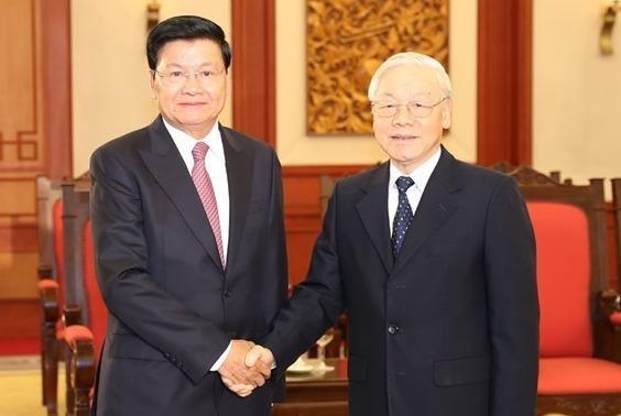 Tong bi thu, Chu tich nuoc tiep Thu tuong Lao Thongloun Sisoulith hinh anh