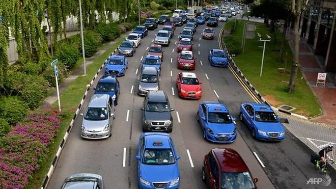 Singapore chi 55 trieu USD ho tro tai xe taxi chong dich virus Vu Han hinh anh 1 cover1.jpg