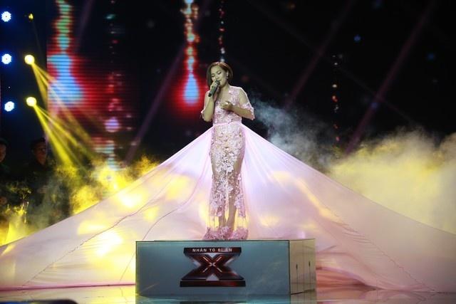 X-Factor 2014: Khan gia xem gi ngoai giong hat hinh anh 1 Minh Ngọc duyên dáng trong chiếc váy hồng được đầu tư khá kĩ lưỡng