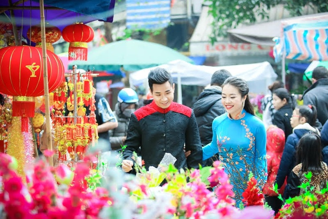 Nguyen Khang dien ao dai di mua hoa o Ha Noi hinh anh 4