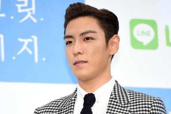 T.O.P (Big Bang) xin loi vi xa rac bua bai o Trung Quoc hinh anh