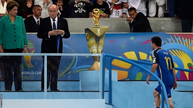 Lionel Messi makes the walk up the stairs to receive his loser