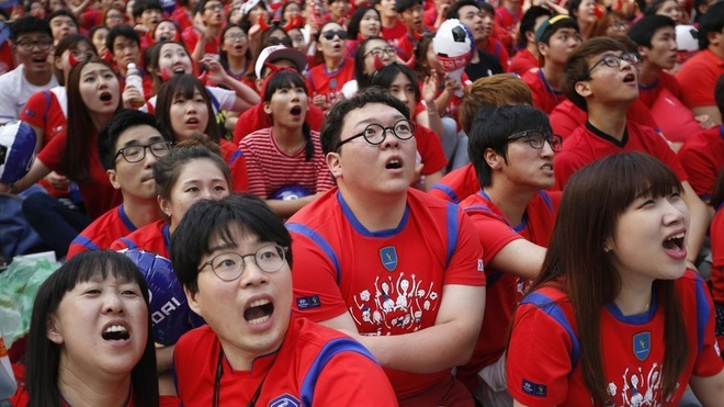Star-gazing. Supporters, including these in Seoul, pack out fan-zones all over the world and Facebook announce there were more than one billion World Cup-related interactions during the first half of the tournament