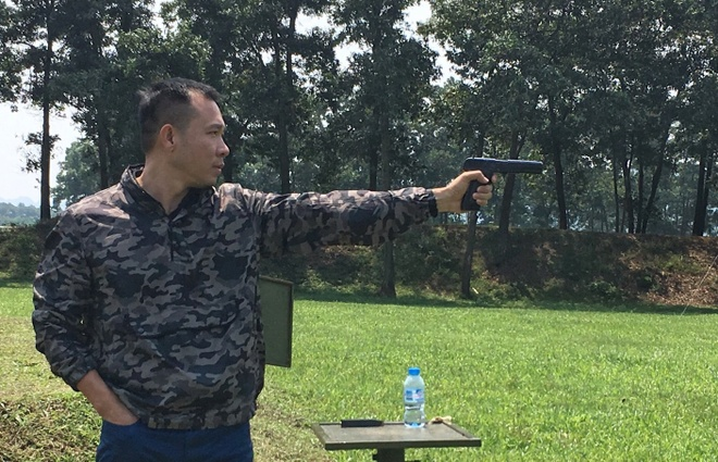 Hoang Xuan Vinh tham gia giai ban sung giao huu hinh anh