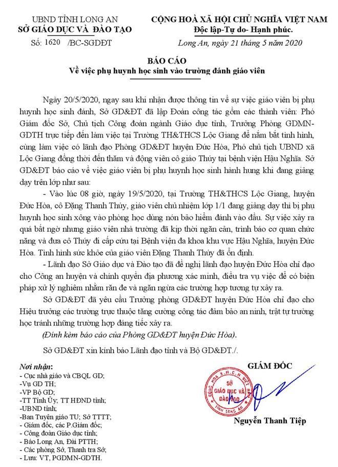 Gia dinh hoc sinh den benh vien xin loi vi danh co giao hinh anh 1 1620_BC_SGDDT_BAO_CAO_CUA_GV_BI_PHHS_DANH_21_5_2020.ok.signed_page_001.jpg