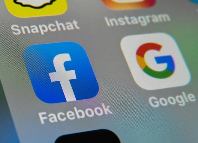Australia buoc Facebook,  Google tra tien tin tuc anh 1