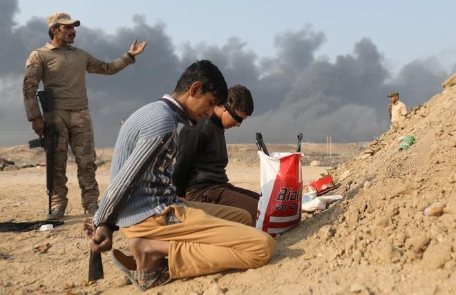 Phien quan IS o Iraq dong loat cao rau de chay tron hinh anh 1