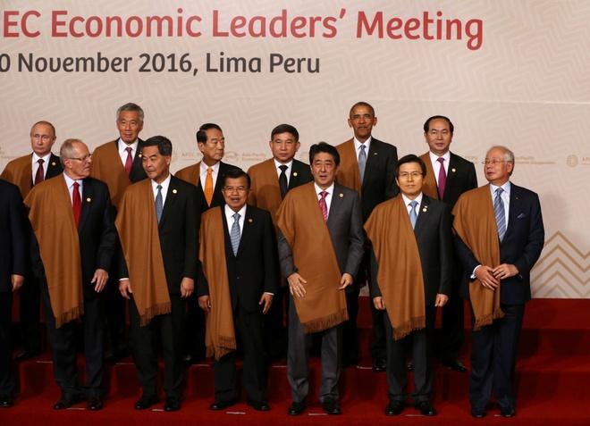Obama no luc cuu van di san tai dien dan APEC hinh anh 2