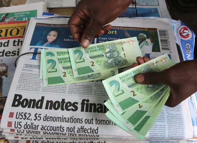 7 nam sau thoi 'sieu lam phat', Zimbabwe phat hanh tien moi hinh anh