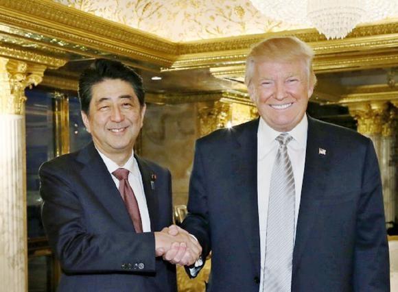 Chinh quyen Obama khong vui voi cuoc gap Abe - Trump hinh anh