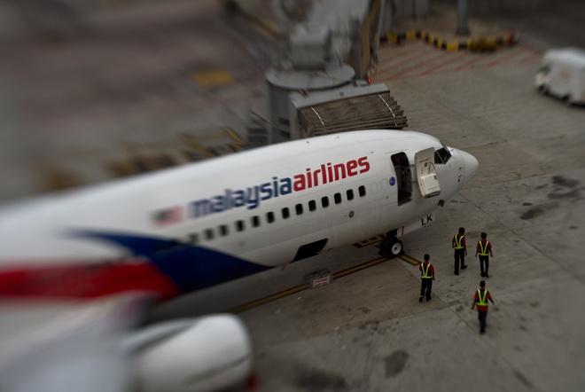 May bay Malaysia Airlines vua cat canh da phai quay dau hinh anh