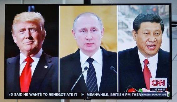 TT Putin, Trump va Tap: Tuan le APEC buoc vao ngay 'nong' nhat hinh anh