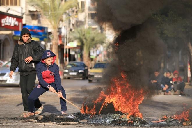 Hamas keu goi nguoi Palestine noi day sau loi 'tuyen chien' cua My hinh anh