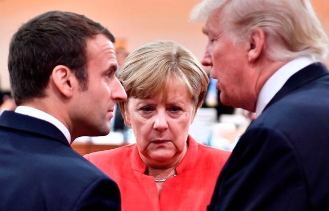Merkel can nhac cung Macron doi dau Trump o Davos hinh anh