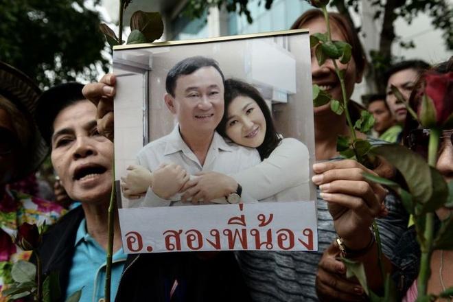 Anh em cuu thu tuong Yingluck xuat hien tai Singapore hinh anh 1