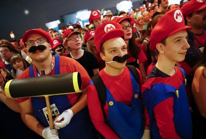 Anh bao lu o chau A an tuong nhat tuan qua (2/8 - 9/8) hinh anh 5 Người dân Đức tham gia một sự kiện kỷ niệm 30 năm ra đời của trò chơi nổi tiếng Super Mario vào ngày 6/8. Ảnh: Reuters
