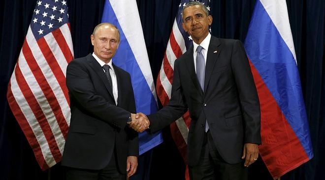 Ong Putin de ngo kha nang tham gia khong kich tieu diet IS hinh anh 1 Tổng thống Obama bắt tay cùng Tổng thống Putin trước cuộc gặp song phương ở trụ sở LHQ. Ảnh: AFP