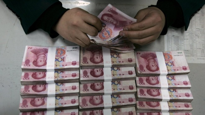 Trung Quoc pha dong chuyen tien trai phep hon 125 ty USD hinh anh 1