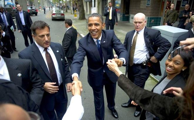 Nguoi 'nhu hinh voi bong' bao ve Tong thong Obama hinh anh 7