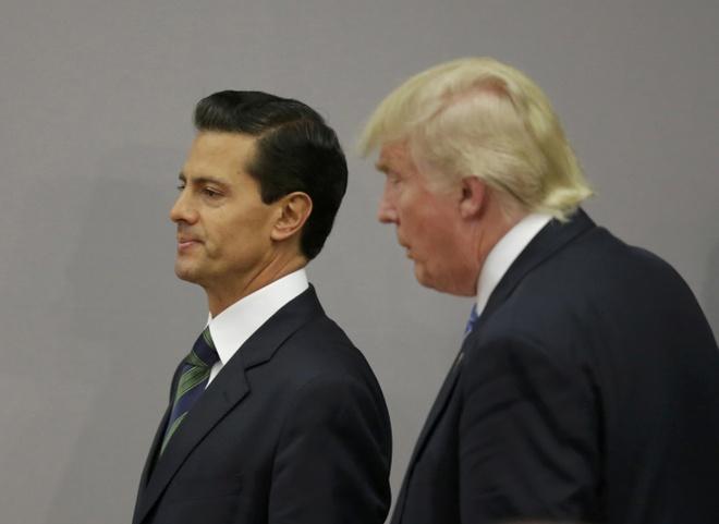Donald Trump tuyen bo lap doi dac nhiem truc xuat nhap cu hinh anh 2