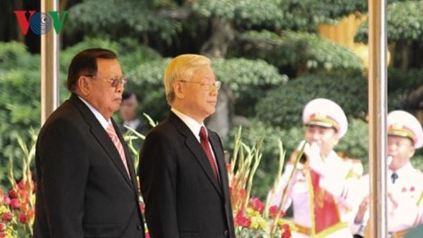Tong bi thu Nguyen Phu Trong tham chinh thuc Lao hinh anh