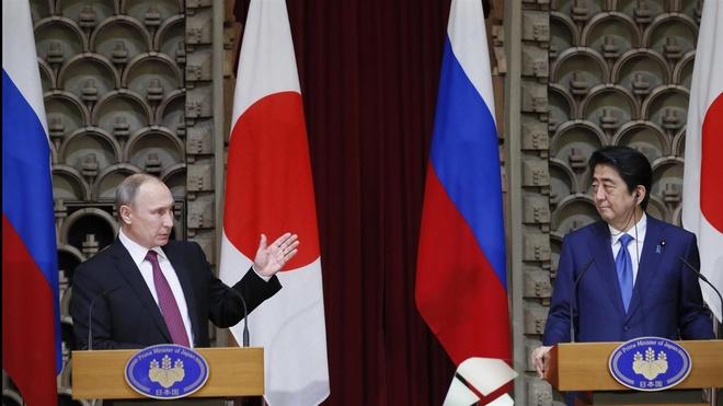Khi ong Putin 'ha guc' Abe tren dat Nhat hinh anh 1